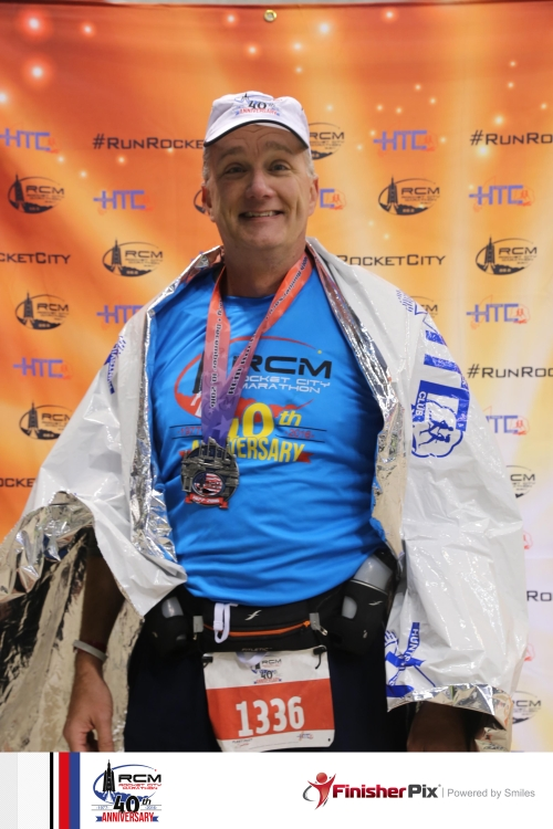 Not all heroes wear capes. But most marathoners do